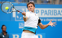 13.06.13 London, England. Edouard Roger-Vasselin in action against Jo-Wilfried Tsonga during the The Aegon Championships from the The Queen's Club in West Kensington.