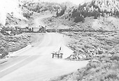 K-36 #489 crossing highway at bottom of east side of Marshall Pass with dismantling train.  Caption: &quot;D&amp;RG next-to-last train to cross this highway on old Marshall Pass Route, Colorado.&quot;<br /> D&amp;RGW  Marshall Pass - Ohaver Lake area, CO