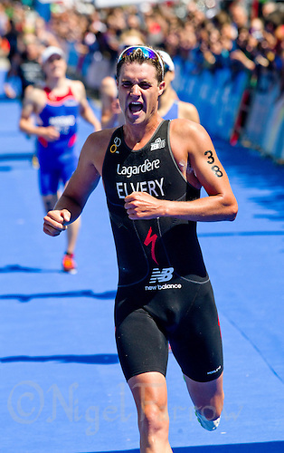 04 JUN 2011 - MADRID, ESP - James Elvery celebrates his finish at the Madrid round of triathlon's ITU World Championship Series  (PHOTO (C) NIGEL FARROW)