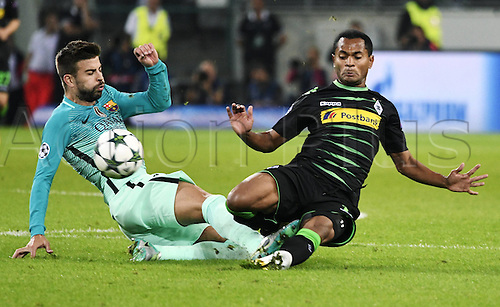 28.09.2016. Moenchengladbach, Germany. UEFA Champions league football. Borussia Moenchengladbach versus FC Barcelona.  Gerard Pique (Barcelona) slides in on Raffael (Gladbach)