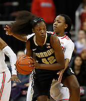 Ohio State Buckeyes guard Ameryst Alston (14) defends against Purdue Boilermakers forward/center Camille Redmon (42) in the first half of  a women's basketball game between the Ohio State Buckeyes and the Purdue Boilermakers at Value City Arena on January 2, 2014. ( Dispatch photo by Fred Squillante)