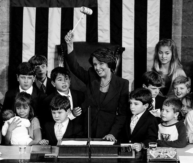 JANUARY 4, 2007: Speaker of the House Nancy Pelosi invites members' children, including her own grandchildren, up to the podium to touch the gavel on the House Floor after being elected Speaker.