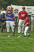 An unidentified member of the  Capitol City Little League Rockies hits the baseball off the tee during a game on the South Lawn of the White House in Washington, DC on May 6, 2001. <br /> Credit: Ron Sachs / CNP