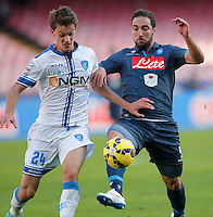Daniele Rugani  Gonzalo Higuain tion during the Italian Serie A soccer match between   SSC Napoli and Empolii    at San Paolo   stadium in Naples , December 07, 2014