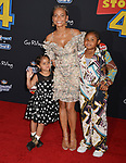 "Christina Milian and kids 033 arrives at the premiere of Disney and Pixar's ""Toy Story 4"" on June 11, 2019 in Los Angeles, California."