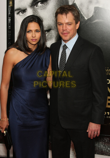 """LUCIANA BARROSO & MATT DAMON.The World Premiere of """"Green Zone"""" held at the AMC Loews Lincoln Square Theater, New York, NY, USA..February 25th, 2010.half length suit jacket black white moustache mustache facial hair white polka dot tie blue one shoulder silk satin dress married husband wife .CAP/LNC/TOM.©LNC/Capital Pictures."""