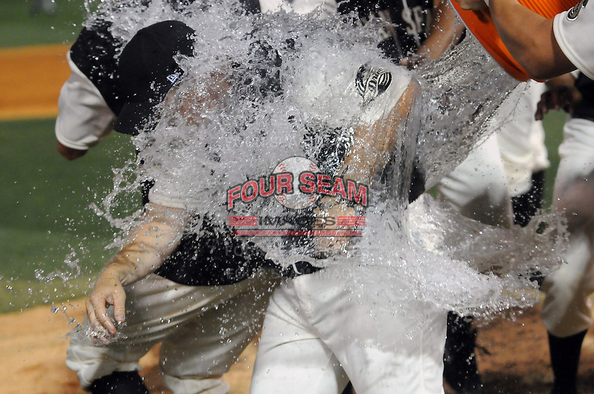 June 20, 2009: Greenville Drive manager Kevin Boles (19) gets doused with a water bucket bath by his players after they won the first half Southern Division title for the South Atlantic League Saturday night with a 15-3 win over the Lexington Legends at Fluor Field at the West End in Greenville, S.C. Photo by: Tom Priddy/Four Seam Images