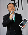 March 16, 2012, Tokyo, Japan - President Masayoshi Son of Japans Softbank introduces a new iPad as Apples retailer kicks off the release of the third-generation tablet computer at its flagship store in Tokyos Ginza shopping district on Friday, March 16, 2012...Apple manias lined up well before the opening of the store to grab the new Apple product. Japan was one of the initial 10 countries where the brand new iPad hit shelves as earely as 8:00 in the morning. (Photo by Natsuki Sakai/AFLO) AYF -mis-.