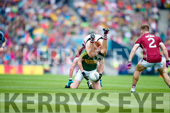 Johnny Buckley Kerry in action against Gary O'Donnell Galway in the All Ireland Senior Football Quarter Final at Croke Park on Sunday.