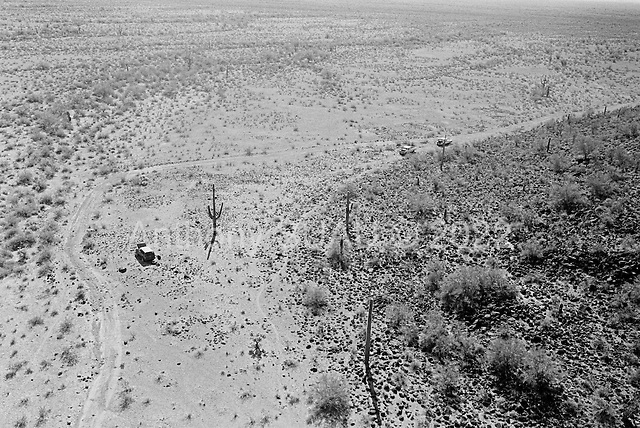 Tohno O'odham Indian Reservation, Arizona<br /> May 5, 2008<br /> <br /> In the Tohno O'odham Indian Reservation along the US Mexican border, abandon vehicles dot the desert. Most are drug smuggler vehicles left by the drivers in the night when the vehicles broke down. Over a thousand vehicles and thousands of smuggler trails run through the deserts reroute from Mexico to any major highway in the US.<br /> <br /> Although new roads, fence and vehicle barrier have been put in place along the US/Mexcian border - Arizona illegal traffic is still very heavy in the Tucson sector.