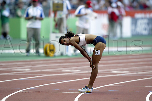 August 24, 2003: Distance runner, 390. JOANNE FENN (GBR) leans over with exhaustion after the Women's 800m Semi-Finals. World Athletics Championships held at the Stade de France, Paris. Photo: Neil Tingle/action plus...runners woman women metres athlete 030824 track and field exhausted rest rests resting tired