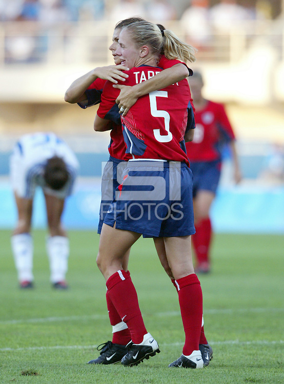 August 11th, 2004:  Mia Hamm celebrates with Lindsay Tarpley after Hamm scored a goal during the second half of the game against Greece at Pankritio Stadium in Heraklio, Greece.  USA defeated Greece, 3-1..Credit: Michael Pimentel / ISI