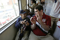 A United States fans predicts a score of 2-0 USA while talking with a Mexican aboard a Metro subway train heading to Azteca stadium. The United States Men's National Team played Mexico in a CONCACAF World Cup Qualifier match at Azteca Stadium in, Mexico City, Mexico on Wednesday, August 12, 2009.