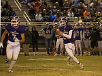 Spanish Springs Cougars quarterback Tristan Szabo rolls out against the Manogue Miners on Friday night, November 9, 2018 at Spanish Springs High School in Sparks, Nevada.