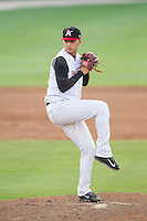 Kannapolis Intimidators relief pitcher Jordan Guerrero (22) in action against the Hickory Crawdads at CMC-Northeast Stadium on May 18, 2014 in Kannapolis, North Carolina.  The Intimidators defeated the Crawdads 6-5 in 10 innings.  (Brian Westerholt/Four Seam Images)
