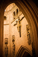 A large crucifix hangs on the inside wall of a beautiful church in France