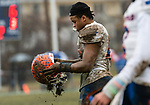 ANSONIA, CT. 02 December 2018-120218 - Bloomfield's Ky'Juon Butler #45 tries to shake out the mud from his helmet during the Class S Semi-final game between Bloomfield and Ansonia at Ansonia High School in Ansonia on Sunday. Bloomfield held on to beat Ansonia 26-19 and advances to the Class S Championship game next week. Bill Shettle Republican-American