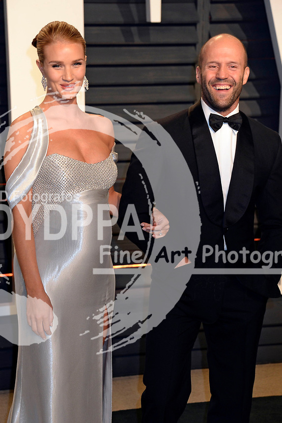 Rosie Huntington-Whiteley and Jason Statham attend the 2017 Vanity Fair Oscar Party hosted by Graydon Carter at Wallis Annenberg Center for the Performing Arts on February 26, 2017 in Beverly Hills, California.