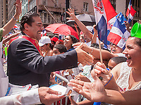 NYC Mayoral candidate, the Rev. Erick Salgado joins thousands of Dominican-Americans and their friends and supporters as he campaigns in the Dominican Day Parade in New York on Sixth Avenue on Sunday, August 11, 2013.  Politicians, flags and cultural pride were on display at the annual event. The primary election is approximately one month away. (© Richard B. Levine)