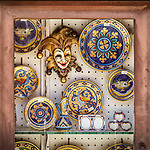 Window display with mask, mosaic plates, Ravenna, Italy