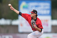 Kannapolis Intimidators starting pitcher Spencer Adams (12) delivers a pitch to the plate against the Lakewood BlueClaws at CMC-Northeast Stadium on May 16, 2015 in Kannapolis, North Carolina.  The BlueClaws defeated the Intimidators 9-7.  (Brian Westerholt/Four Seam Images)