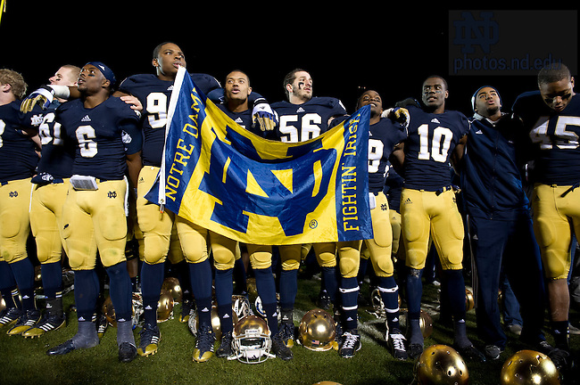 Nov. 3, 2012; Players sing the Notre Dame alma mater after defeating  Pittsburgh 29 to 26 in triple overtime. Photo by Barbara Johnston/University of Notre Dame