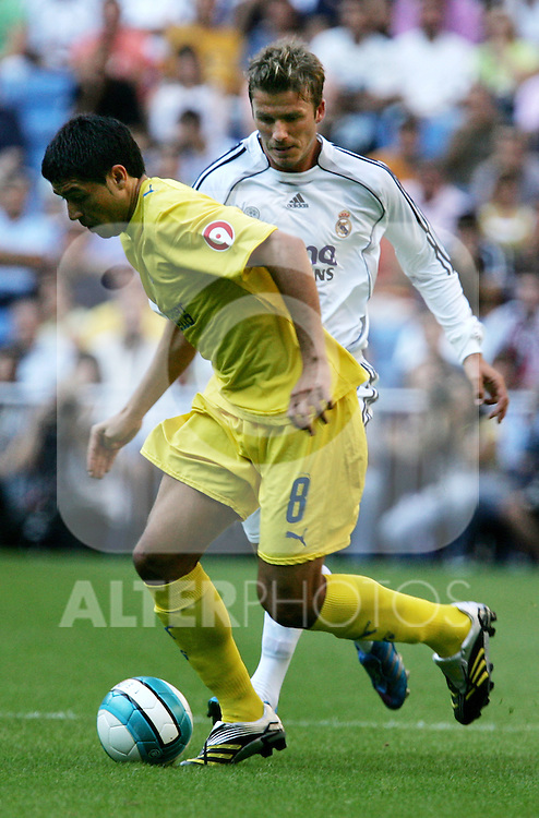 Real Madrid's David Beckham challenges Villareal's Juan Roman Riquelme during their Spanish La Liga match against Villareal at Santiago Bernabeu Stadium in Madrid, Sunday August 27 2006. (ALTERPHOTOS/Alvaro Hernandez).
