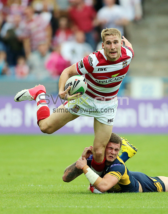 PICTURE BY VAUGHN RIDLEY/SWPIX.COM - Rugby League - Challenge Cup Semi-Finals - Leeds Rhinos v Wigan Warriors - The Galpharm Stadium, Huddersfield, England - 14/07/12 - Wigan's Sam Tomkins is tackled by Leeds Zak Hardaker.