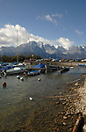 Boats moored on Lake Léman, with snow covered mountains in the background. Clarens close to Montreux Switzerland.
