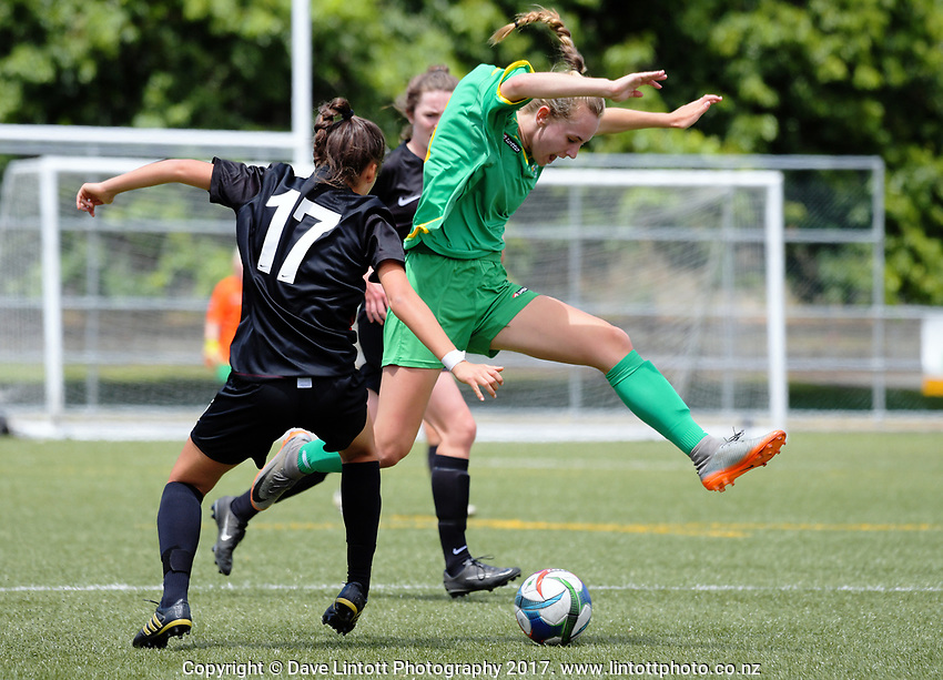 Action from the New Zealand Age Group Championships Under-16 Girls match between Central (green tops) and Mainland at Maidstone Park in Upper Hutt, Wellington, New Zealand on Thursday, 14 December 2017. Photo: Dave Lintott / lintottphoto.co.nz