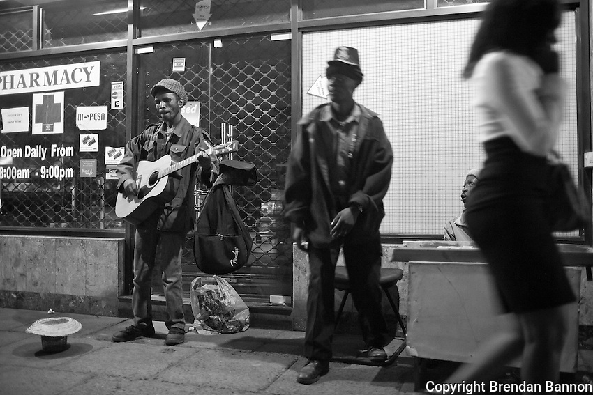 Busker, Kimoja, performs nightly on the strets of Westlands in Nairobi.