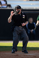 Umpire Mike Trotter makes a call during a game between the Siena Saints and Central Florida Knights at Jay Bergman Field on February 16, 2014 in Orlando, Florida.  UCF defeated Siena 9-6.  (Mike Janes/Four Seam Images)