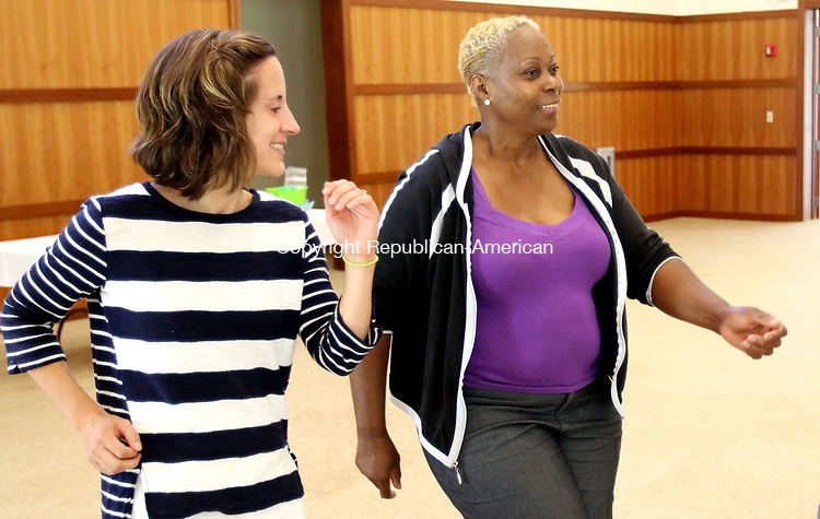 SOUTHBURY CT. 09 August 2017-080917SV07-From left, Meredith Hettler, program manager, dances a few movies with Janice Nelson of Danbury to the music of Ethel Kaufman during the Love &amp; Knishes Lunch at the Jewish Federation of Western Connecticut in Southbury Wednesday.<br /> Steven Valenti Republican-American