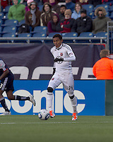 DC United midfielder Andy Najar (14) at midfield. In a Major League Soccer (MLS) match, the New England Revolution defeated DC United, 2-1, at Gillette Stadium on March 26, 2011.