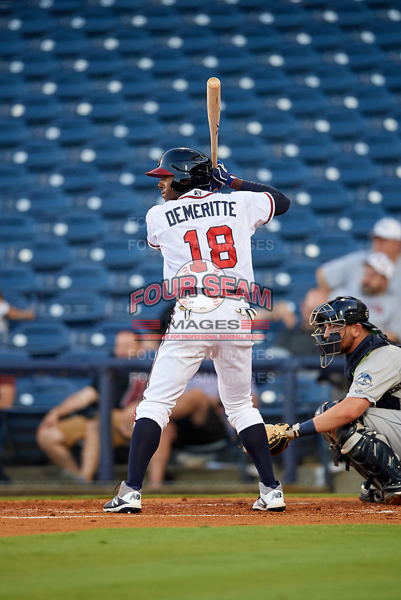 Mississippi Braves left fielder Travis Demeritte (18) at bat in front of catcher Michael Barash (16) during a game against the Mobile BayBears on May 7, 2018 at Trustmark park in Pearl, Mississippi.  Mobile defeated Mississippi 5-0.  (Mike Janes/Four Seam Images)