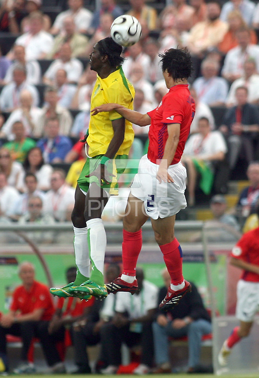Togo's Emmanuel Adebayor (left) and Korea Republic's Young Chel Kim (2) go up for a header. Korea Republic defeated Togo 2-1 in their FIFA World Cup Group G match at the FIFA World Cup Stadium, Frankfurt, Germany, June 13, 2006.