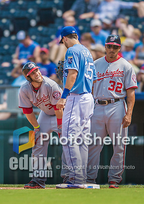 25 August 2013: Washington Nationals outfielder Bryce Harper looks up to Kansas City first baseman Eric Hosmer during a game against the Kansas City Royals at Kauffman Stadium in Kansas City, MO. The Royals defeated the Nationals 6-4, to take the final game of their 3-game inter-league series. Mandatory Credit: Ed Wolfstein Photo *** RAW (NEF) Image File Available ***