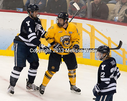 Rob O'Gara (Yale - 4), Zach Davies (QU - 3), Tommy Fallen (Yale - 22) - The Yale University Bulldogs defeated the Quinnipiac University Bobcats 4-0 in the 2013 Frozen Four final to win the national championship on Saturday, April 13, 2013, at the Consol Energy Center in Pittsburgh, Pennsylvania.