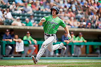 Gwinnett Stripers catcher Rob Brantly (8) runs home during a game against the Columbus Clippers on May 17, 2018 at Huntington Park in Columbus, Ohio.  Gwinnett defeated Columbus 6-0.  (Mike Janes/Four Seam Images)