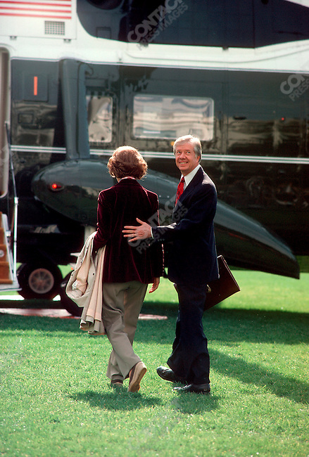 U.S. President Jimmy Carter with his wife Rosalynn, boarding Marine One, Washington, D.C., November 1980