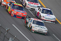 Oct 5, 2008; Talladega, AL, USA; NASCAR Sprint Cup Series driver Dale Earnhardt Jr (88) leads teammate Jeff Gordon (24) and Travis Kvapil (28) during the Amp Energy 500 at the Talladega Superspeedway. Mandatory Credit: Mark J. Rebilas-