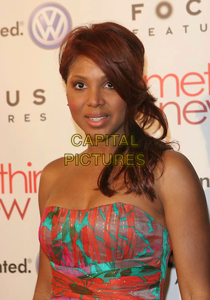 "TONI BRAXTON.""Something New"" Los Angeles Premiere held at The Cinerama Dome, Hollywood, California..January 24th, 2006.Photo: Zach Lipp/AdMedia/Capital Pictures.Ref: ZL/ADM.half length strapless.www.capitalpictures.com.sales@capitalpictures.com.© Capital Pictures."