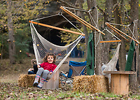 NWA Democrat-Gazette/BEN GOFF @NWABENGOFF<br /> Laurel Jones, 5, of Bella Vista swings in a hammock chair Saturday, Nov. 3, 2018, during the first public 'Cave Party' at Hole in the Wall NWA in Bella Vista. Guests to the free event had a chance to check out the cave while enjoying food, live music, campfires and stargazing with Explore Scientific USA. Overnight camping was also offered with a reservation. Owners Julie Duncan and Duane Paterson purchased the property three years ago with the idea of building their dream home, but are now trying to make the property a camping and event space. The 12 acre property with a cave, open meadow and woods sits only a short distance from a future addition to the Back 40 mountain bike trail system.