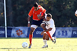 10 November 2010: Virginia's Brian Span (23) and Wake Forest's Sam Redmond (22). The University of Virginia Cavaliers defeated the Wake Forest University Demon Deacons 1-0 at Koka Booth Stadium at WakeMed Soccer Park in Cary, North Carolina in an ACC Men's Soccer Tournament Quarterfinal game.
