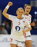 BELGRADE, SERBIA - DECEMBER 16:  Ida Alstad (L) of Norway celebrates the goal during the Women's European Handball Championship 2012 gold medal match between Norway and Montenegro at Arena Hall on December 16, 2012 in Belgrade, Serbia. (Photo by Srdjan Stevanovic/Getty Images)