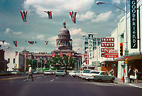 Vintage 1960s view of the Texas State Capitol and downtown Austin from 9th and Congress Avenue