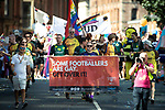"""© Joel Goodman - 07973 332324 - all rights reserved . 24/08/2019. Manchester, UK. """" Some Footballers are gay get over it """" banner . The 2019 Manchester Gay Pride parade through the city centre , with a Space and Science Fiction theme . Manchester's Gay Pride festival , which is the largest of its type in Europe , celebrates LGBTQ+ life . Photo credit: Joel Goodman/LNP"""