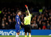 25th February 2020; Stamford Bridge, London, England; UEFA Champions League Football, Chelsea versus Bayern Munich; Referee Clement Turpin giving a red card to Marcos Alonso of Chelsea after checking the VAR monitor as Jorginho of Chelsea protests to Referee Clement Turpin
