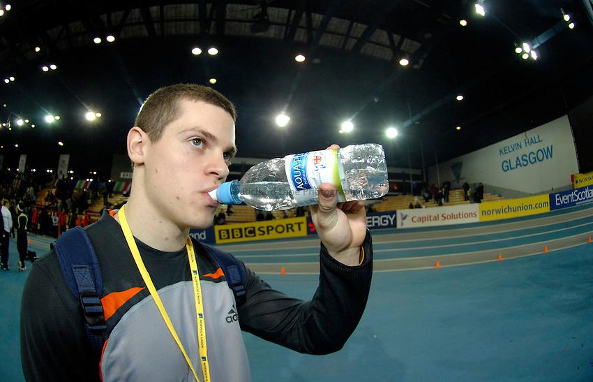 Photo: Richard Lane..Norwich Union International, Glasgow. 27/01/2007. .Great Britain's Craig Pickering drinks of Aqua-Pura water.
