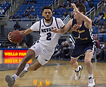 Nevada guard Jalen Harris (2) drives past Colorado Christian forward AidenCantwell (1) during the second half of an NCAA college basketball game in Reno, Nev., Wednesday, Oct. 30, 2019.